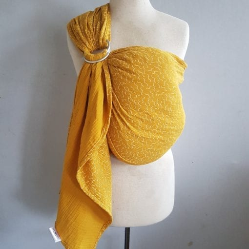 ochre yellow sling with white squiggly pattern